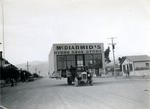 McDiarmid's Hydro Shoe Store. Truck transporting building