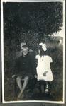 Boy and girl in a garden