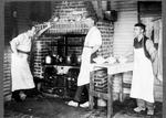 Waitaki Farmers' Freezing Company, Pukeuri, early 1920s. Three gentlemen with aprons on in front of range cooking