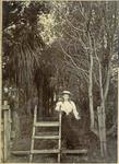 Girl at a fence stile