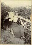 Woman sitting in a garden with a dog