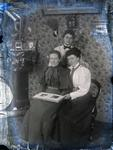 Unidentified women with photo album