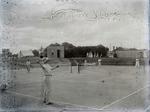 Unidentified men and women playing tennis