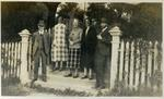 Unidentified men and women at a gate