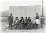 Unidentified men with dog