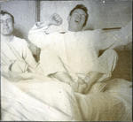 Men sitting on a bed