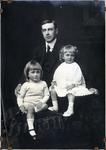 Portrait of man with two children, unidentified