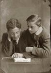 Boys reading, unidentified