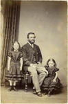 Unidentified man with two young girls