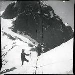 Two men on a mountain peak