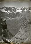 Man standing on a mountain top, Cleddau Valley