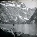 Men beside a mountain lake