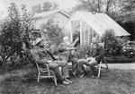McAdam, Thomas Forrester, Dr K McAdam sitting  in a garden at Forrester's residence